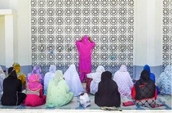 Women praying at a mosque