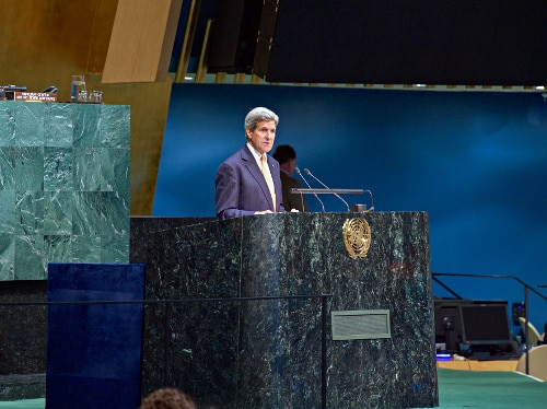 Secretary Kerry speaks from the podium in the UN General Assembly in New York as he addresses the 2015 Review Conference of the Parties to the Treaty on the Non-Proliferation of Nuclear Weapons (State Dept)