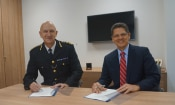 City of London Police Commissioner Adrian Leppard and ICE London Attaché Matthew Etre sign the official memorandum of understanding.