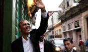 President Obama waves to onlookers as he tours teh capital of Cuba, Havanna.