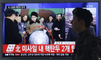 """FILE - A South Korean army soldier walks by a TV screen showing North Korean leader Kim Jong Un with superimposed letters that read: """"North Korea's nuclear warhead"""" during a news program at Seoul Railway Station in Seoul, South Korea, March 9, 2016."""