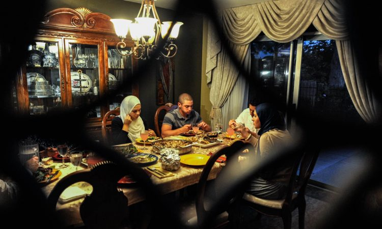 A family breaks the Ramadan fast at their home in California.