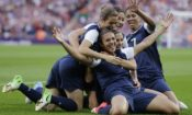 Carli Lloyd, center, celebrates with teammates after scoring during the women's soccer gold medal match at the 2012 London Olympics. (© AP Images)
