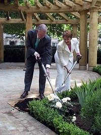Ambassador William Farish and Tessa Jowell planting white roses in the memorial garden in Grosvenor Square on July 7, 2003.
